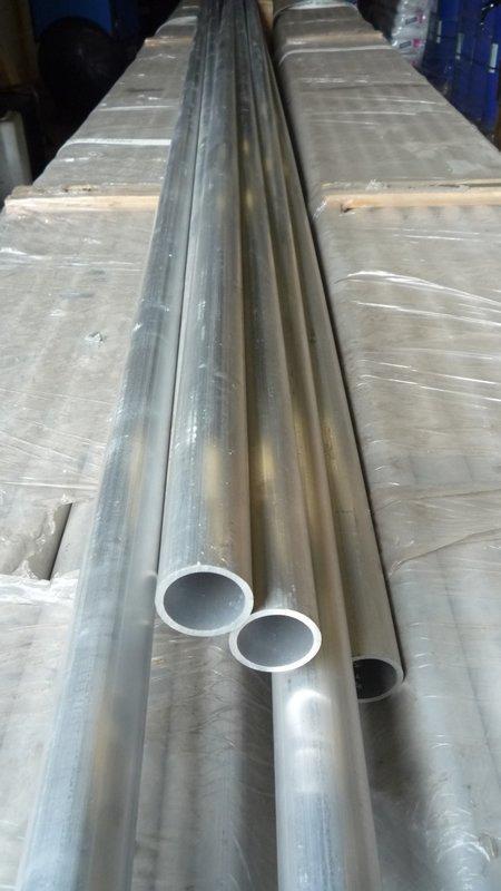 A pile of 20ft aluminium scaffold poles