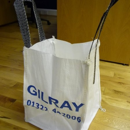 an empty branded rubble sack with handles