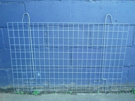 zinc plated swivel brick guard leaning against a wall