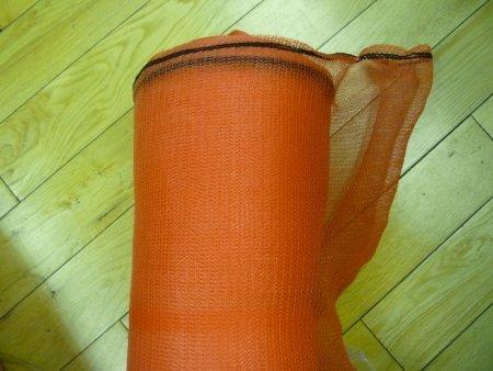 a roll of orange debris netting