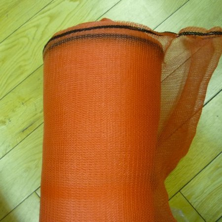 a roll of orange debris netting