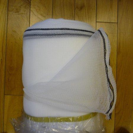A roll of white debris netting