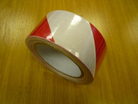 Red and white hazard tape for sale at gilray plant