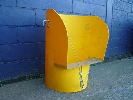 a rubbish chute hopper in yellow
