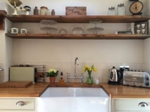 Kitchen shelves made from reclaimed scaffold boards